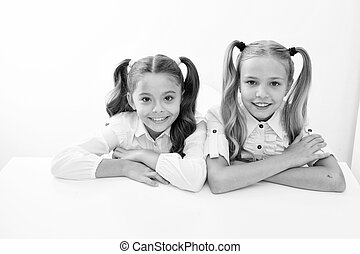 e learning. happy childhood od cute little girls. e learning for little girls isolated on white.