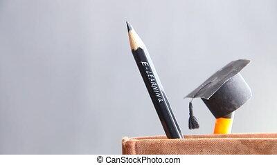 E-learning school idea, inscription in pencil and book