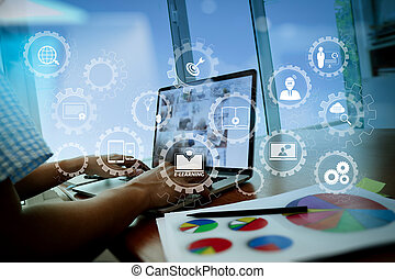 E-learning with connected gear cogs connected diagram virtual dashboard. business documents on office table with smart phone and digital tablet and graph business diagram and man working in the background