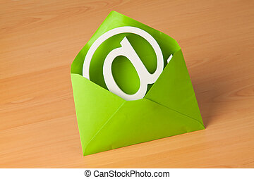E-mail logo in an envelope - E-mail sign is in a green...