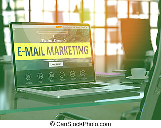 E-Mail Marketing on Laptop in Modern Workplace Background.