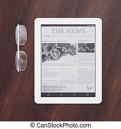 E-reader with newspaper application and glasses top view