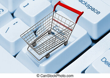 E-shopping - Shopping cart on computer keyboard