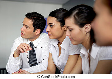 Eager businesspeople in meeting