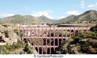 Nerja, Spain - May 30, 2019: View of the historical Eagle Aqueduct close to Nerja