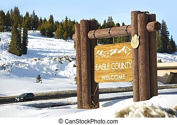Eagle County Welcome Wooden Sign Located on Vail Pass Summit...