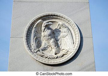 Eagle emblem under a statue on the Castle Bridge in Berlin