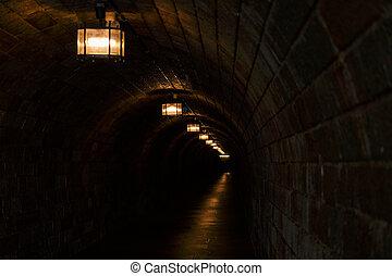 Eagle Nest dark tunnel with orange lights