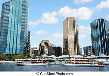 BRISBANE, AUS - SEP 25 2014:Riverboats mooring at Eagle Street Pier. It is an iconic waterfront precinct with world class dining options and unrivaled views of the Brisbane River.