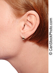 Ear - Close-up shot of redhead woman's ear with earring