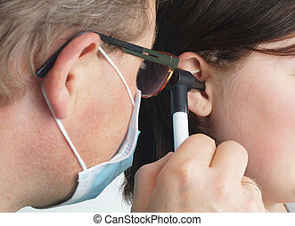Ear doctor examines a child