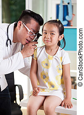 Ear examination at pediatrician's office