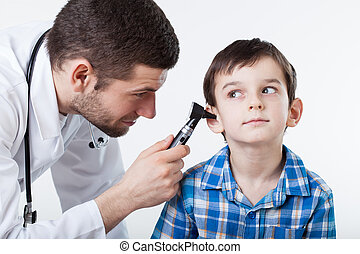 Ear examination - Physician performing ear examination...