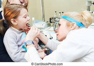 Pediatric otolaryngology ear examining  Young male
