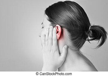 Ear pain - Young woman touching her painful ear