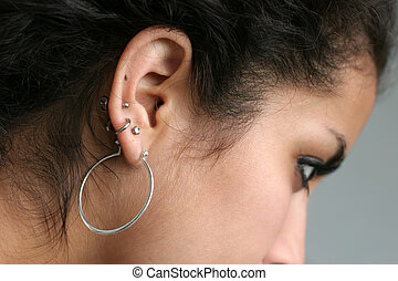 Ear piercing - Abstract of a girl with pierced ears
