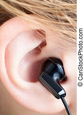 Ear with Earbud - Ear Close Up with Black Earbud
