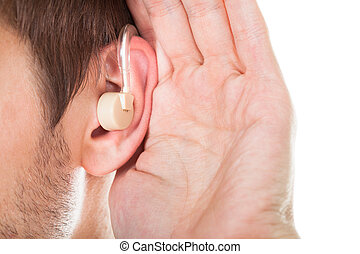 Ear With Hearing Aid - Close-up Of An Ear With Hearing Aid