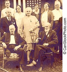 EARLY 1900s GROUP OF MEN AND WOMEN - Five men and four women...