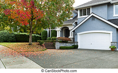 Early autumn with modern residential single family home -...