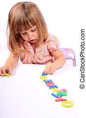 Early childhood development - Young girl playing with...