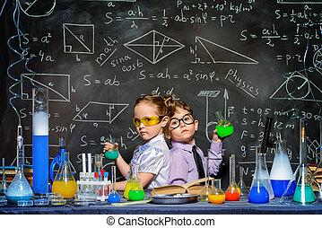 early children development - Two little children scientists...
