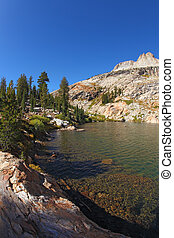 Early clear autumn morning. Picturesque transparent lake in mountains Yosemite national park