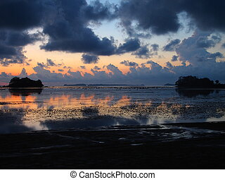 Early dawn at sea at low tide