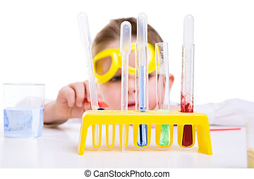 Early education - Young boy performing chemistry experiments...