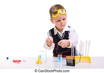 Early education - Young boy performing experiments with ...