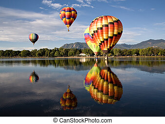 Early Morning Ascension - Hot air balloons touch down in...