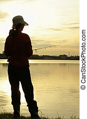 Early morning fishing lady