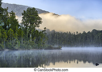 Early morning fog at Lake Kaniere, New Zealand