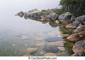 Early morning fog on Jordon Pond, Acadia National Pond, Maine, United States