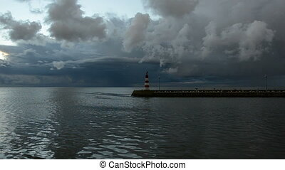 morning sea clouds and lighthouse