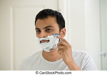 Early morning shave - Closeup portrait, guy in white t shirt...