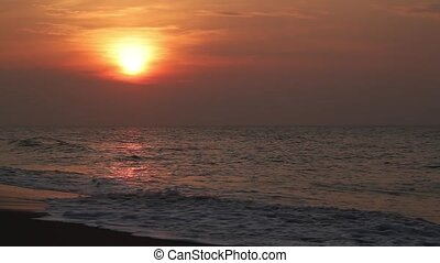 Loop features a beautiful early morning sky above a beach with waves crashing and wet sand reflecting the rising sun.