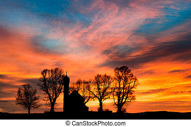 Early morning sunrise dawn with silhouette small church or chapel
