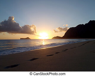 Early Morning Sunrise on Waimanalo Beach over Rock Island bursting through the clouds