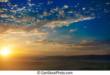 Early morning, the sun rises, mountain