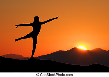Early Morning Yoga - Young woman relaxing with early morning...