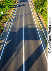early shadow on an empty road