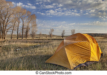 early spring camping in Wyoming - a tent covered by frost in...