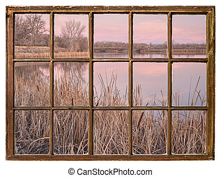 early spring dawn over a calm lake