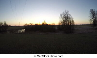 Early spring landscape with pond and sunrise, time lapse
