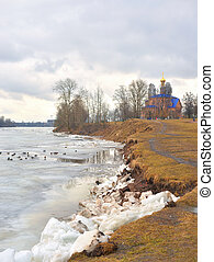 Early spring park. - Early spring park and coast of river at...