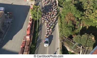 Early stage of a bicycle race seen from above