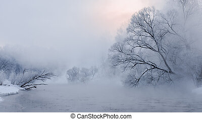 early sunrise over trees covered with hoar near a river