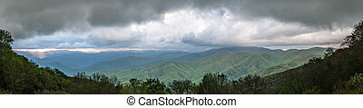 Early Sunset Light Breaks Through Clouds Over Blue Ridge Mountains