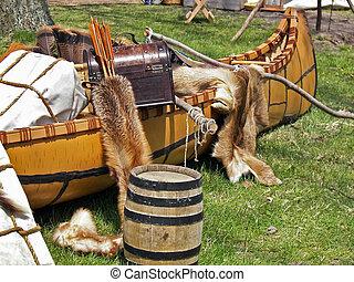 Early Trading - Fur pelts in Indian canoe.